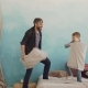 Adorable Playful Boy Is Fighting Pillows, Laughing and Having Fun with His Loving Father. Cheerful - VideoHive Item for Sale