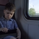 The Boy Is Riding in the Train, Playing Games on the Tablet - VideoHive Item for Sale