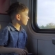The Boy Is On the Train, Playing Games on the Tablet - VideoHive Item for Sale