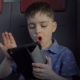 Boy Riding in the Train Playing Games on the Tablet - VideoHive Item for Sale