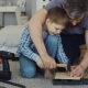 Father Bearded Man Is Teaching His Son How To Use Hammer Driving Nail in Piece of Wood Together - VideoHive Item for Sale