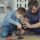 Careful Father Is Teaching His Son To Work with Electric Screwdriver - VideoHive Item for Sale