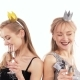 2 Beautiful Cheerful Twin Girls with Glasses of Champagne Dancing in the Studio on a White - VideoHive Item for Sale