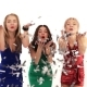 3 Beautiful Girls in Bright Dresses Blowing on Confetti at a Party - VideoHive Item for Sale