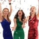 Three Beautiful Girls in Bright Dresses Throwing Confetti at Party in Studio on White Background - VideoHive Item for Sale