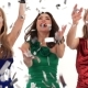 3 Beautiful Girls in Bright Dresses Throwing Confetti at a Party in a Studio on a White Background - VideoHive Item for Sale