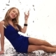 Beautiful Girl in Blue Dress Posing in Studio with a Glass of Champagne on a White Background - VideoHive Item for Sale