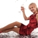 Beautiful Girl in Red Dress Posing in Studio with a Glass of Champagne on a White Background - VideoHive Item for Sale