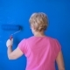 Adult Woman Painting Interior Wall of House with Blue Paint - VideoHive Item for Sale