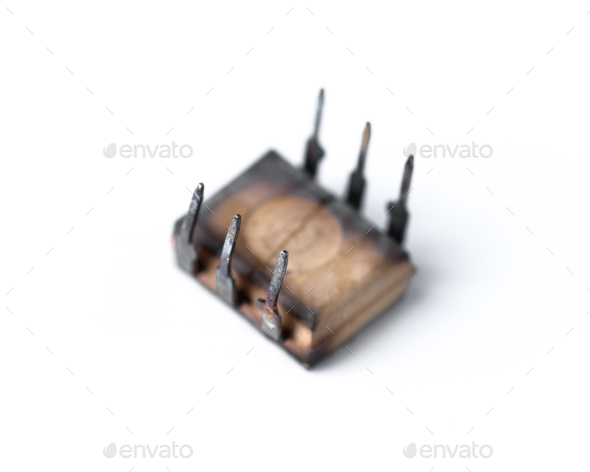 burnt microchip isolated on white background - Stock Photo - Images