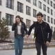 Young Man and His Girlfriend Ride Skateboards Around the City - VideoHive Item for Sale