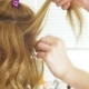 Hair Stylist Makes a Curls for a Girl, Using Hair Styling. Hairdresser at Work - VideoHive Item for Sale