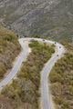 Curved asphalt mountain road with motorcycles. Rural scenic travel. Vertical - PhotoDune Item for Sale