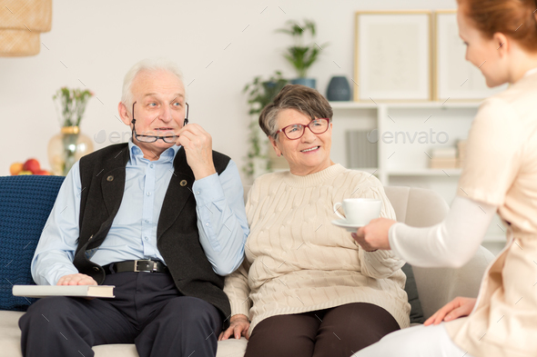 Elderly couple and nurse - Stock Photo - Images