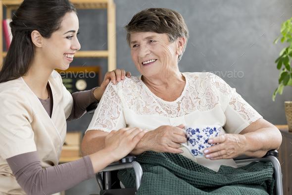 Caregiver talking to pensioner - Stock Photo - Images