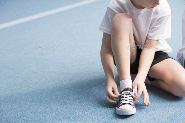 Boy tying his shoes - Stock Photo - Images