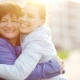 Happy Mother and Her Adult Daughter Gently Embrace and Joyfully Look at the Camera - VideoHive Item for Sale