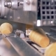 Waffle Cups Are Getting Removed From the Conveyor Belt To the Metal Duct - VideoHive Item for Sale