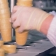 A Pile of Waffle Cups Is Getting Inserted Into the Conveyor Belt By a Factory Worker - VideoHive Item for Sale