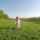 Little Girl Laughing and Running in Garden at Sunset - VideoHive Item for Sale