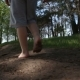 The Boy Walks the Forest Road Barefoot - VideoHive Item for Sale