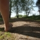 Mother and Son Walking Barefoot Along the Forest Road - VideoHive Item for Sale