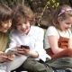 Schoolchildren Play Games on Smartphones during a School Break - VideoHive Item for Sale