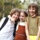 Brothers and Sister Cheerfully Embrace Each Other on the Way To School. Day of Knowledge. Back To - VideoHive Item for Sale