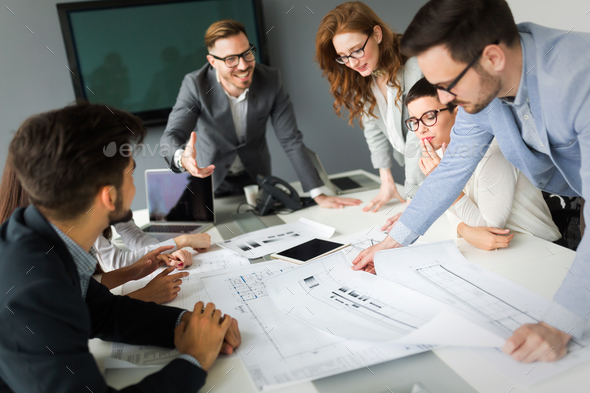 Group of architects working on project - Stock Photo - Images