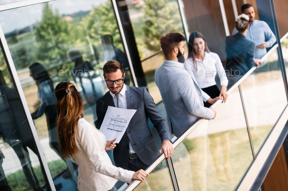 Young designers talking on break about business plans - Stock Photo - Images