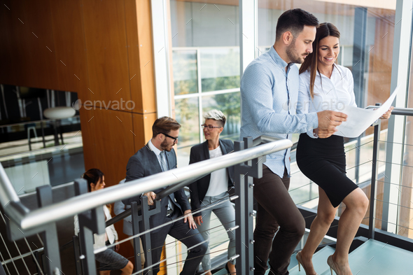 Picture of businessman and businesswoman having discussion - Stock Photo - Images