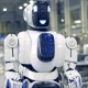 Smiling Robot Is Walking Forwards in Factory Premises - VideoHive Item for Sale