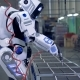 Human-like Robot Is Working with a Drill in a Factory Unit - VideoHive Item for Sale