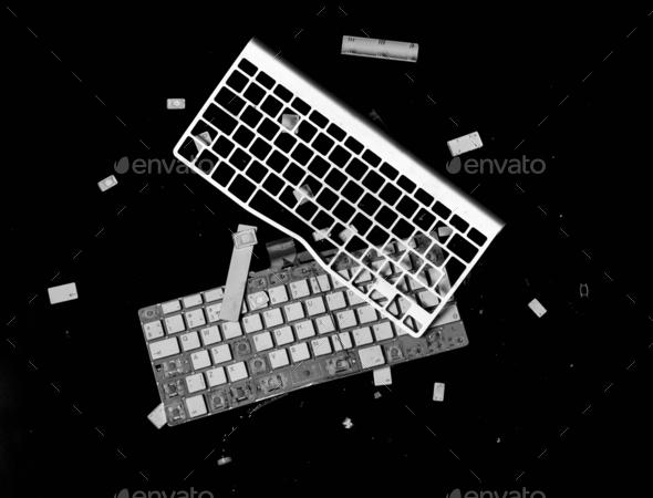 smashed keyboard isolated on black background - Stock Photo - Images