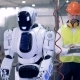 Human-like Robot Starts Working with a Drill After a Corresponding Command From a Factory Worker - VideoHive Item for Sale