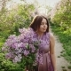The Girl Runs Along with a Bouquet of Lilacs - VideoHive Item for Sale