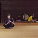 A Man Sitting on the Floor and Playing Flute - VideoHive Item for Sale