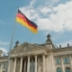 Flag of Germany Fluttering in the Wind Against the Backdrop of the Reichstag in Berlin - VideoHive Item for Sale