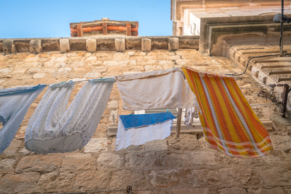 Laundry drying on a clothesline - Stock Photo - Images