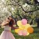 A Girl of Ten Years Playing with Balloons in an Apple Orchard - VideoHive Item for Sale