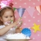 Dirty Hands of a Child in a Cake. Birthday and Party. Funny Girl Licks Her Fingers with Dessert. - VideoHive Item for Sale
