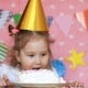 Birthday. Happy Child Girl Is Eating a Cake - VideoHive Item for Sale