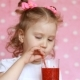 Child Girl Drinks a Berry Smoothie Through a Straw - VideoHive Item for Sale