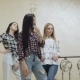Three Beautiful Girls Stand in Pose at Stairs in Home - VideoHive Item for Sale