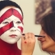 Makeup Artist Painting with Red Color on the Face - VideoHive Item for Sale