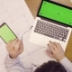 Laptop and Tablet with Green Screen on the Table - VideoHive Item for Sale