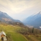 The Drone Is Fly Vertically Up Above the Tree and Shows a View of European Alps Covered in Snow - VideoHive Item for Sale