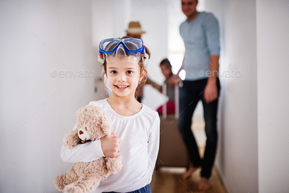 Young family with two children going on a holiday. - Stock Photo - Images