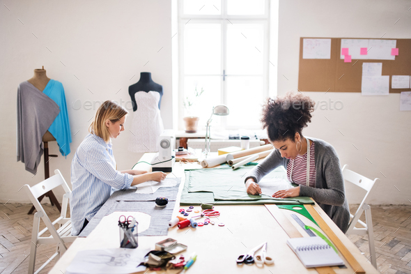 Young creative women in a studio, startup business. - Stock Photo - Images