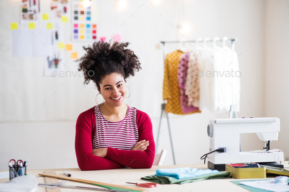Young creative woman in a studio, startup business. - Stock Photo - Images